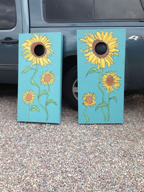 Hand made & hand painted wedding corn hole boards. Fun