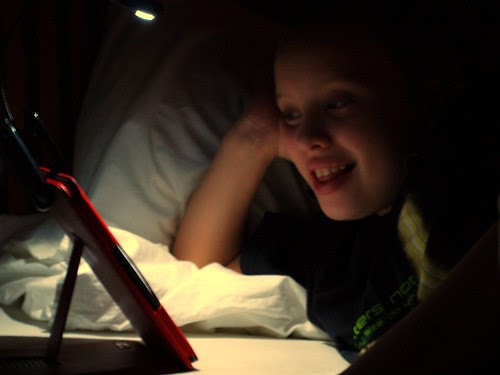 Day #231 reading Kindle with night light by edtechie99, on Flickr