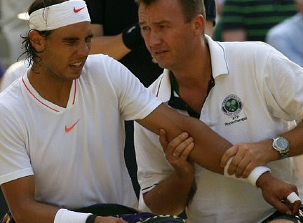 Rafal Nadal shakes off knee, elbow pain to advance at ...