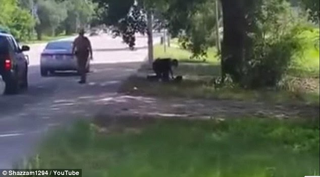 Video shows bland in the confrontation with police and accusing them of slamming her head onto the ground