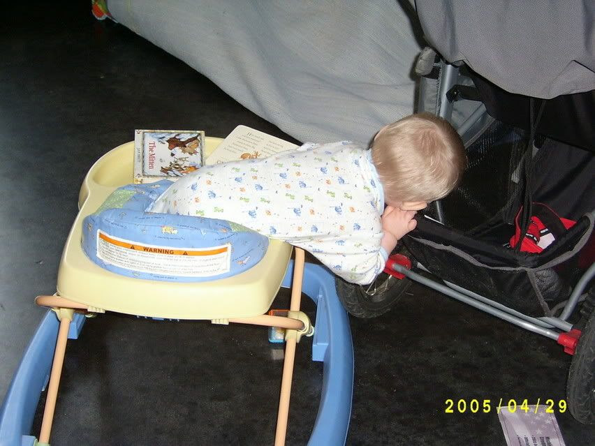 Gabriel climbing out of his walker to get a block from his shelf