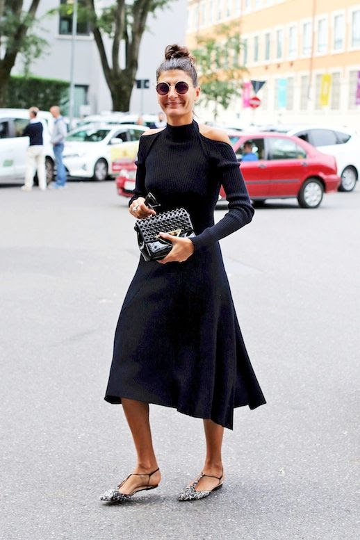 Le Fashion Blog Street Style Giovanna Battaglia Top Knot Round Sunglasses Black Cold Shoulder Dress Patent Bag Printed Pointed Toe Flats Via NYTimes