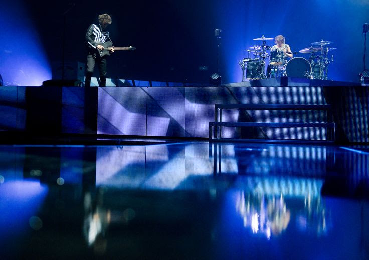 (Molly J. Smith   Special to The Salt Lake Tribune)   Lead singer and guitarist Matthew Bellamy of Muse and drummer Dominic Howard perform at the Energy Solutions Arena in Salt Lake City, Utah, on Sept. 20, 2013.
