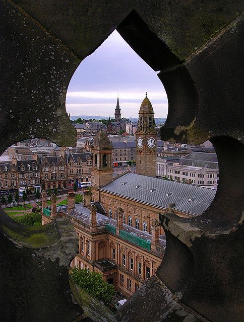 Looking down on Paisley Town Hall. Taken through the wall on the top of Paisley Abbey.