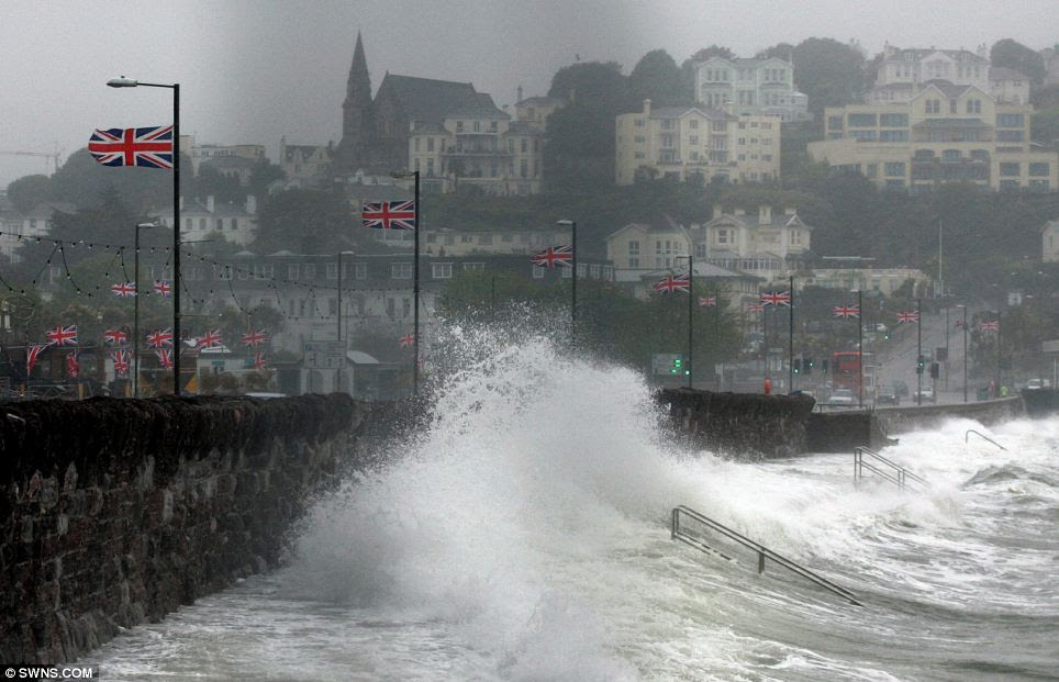 Torquay seafront in Devon at high tide this morning as gales and heavy rain spread across the UK from the southwest of England
