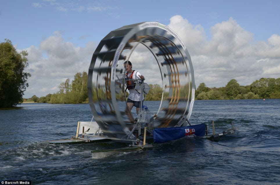 Chris Todd walks on water with the help of his self built 'tredalo'. He is attempting to walk across the Irish Sea in the contraption