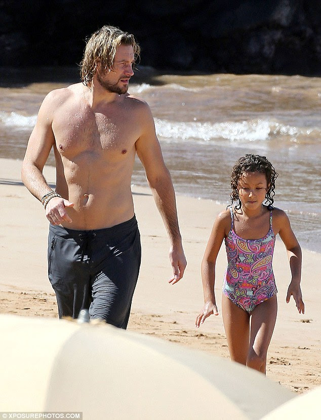 That was fun: Gabriel and Nahla padded across the sand after their sea-faring adventure