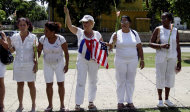 In this photo taken Sunday Sept. 18, 2011, members of the Ladies in White take part in their group's weekly march in Havana, Cuba. The grounds on which the Ladies walked shifted earlier this year, following a a deal between President Raul Castro and the Roman Catholic church that freed the last of their husbands and sent many into exile in Spain. It was the Ladies' greatest victory, but it also robbed them of their founding cause. Now, they and the rest of the island's dissident community stand at a crossroads with the challenge of redefining themselves. (AP Photo/Franklin Reyes)