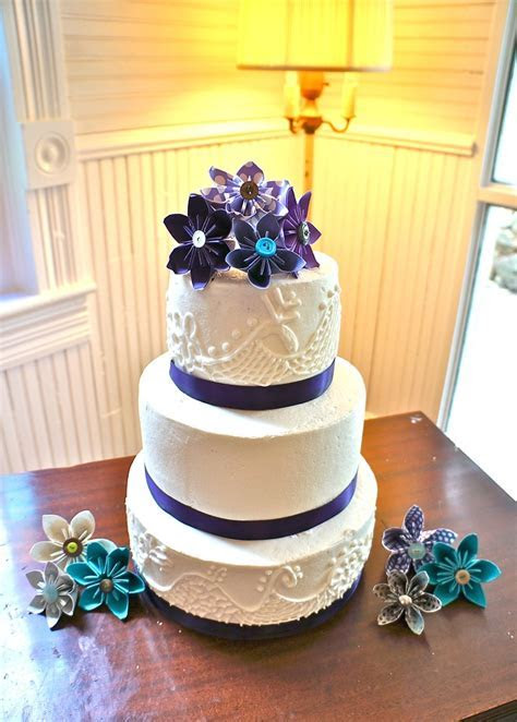 3 tier buttercream cake with royal icing lace and ribbon