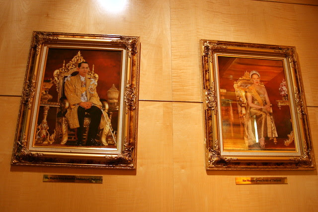 It's a Thai hotel! The portraits of the King and Queen oversee the concierge