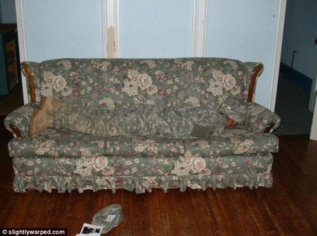 Undercover: A soldier's camouflage uniform hides him in a slightly more domestic situation than it was intended