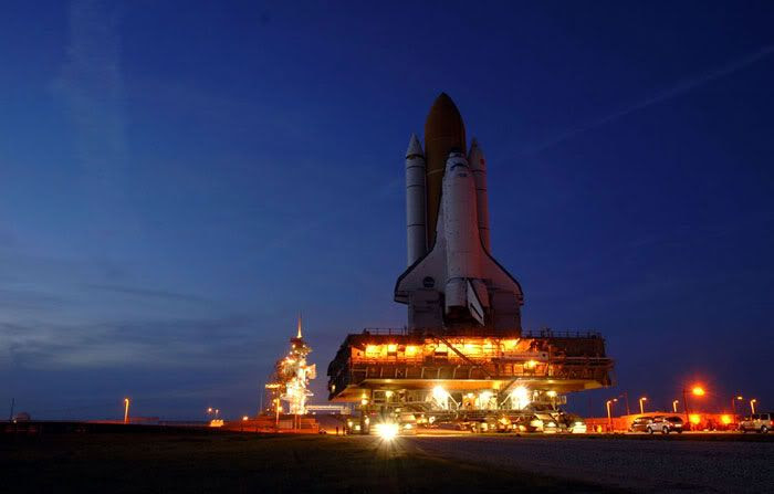 Space Shuttle Discovery approaches its launch pad.