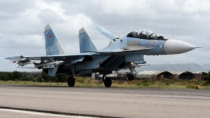 A Russian Sukhoi Su-35 bomber lands at the Russian Hmeimim military base in Latakia province, in the northwest of Syria on May 4, 2016.