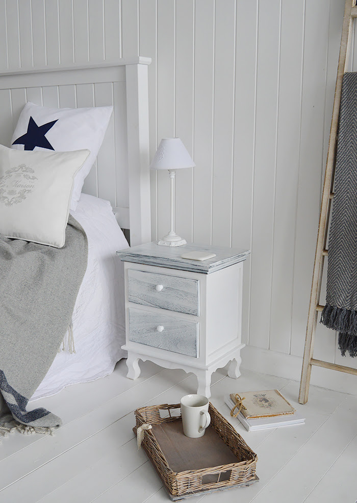 Slightly distressed furniture works best for coastal interiors, to resemble weathern worn wood beaten by the endless waves. The Shoreham bedside cabine in blue and white hues with a distressed finish
