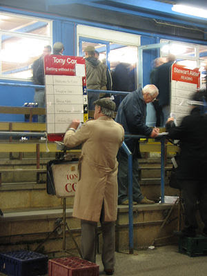 Bookmakers at the dog races in Reading, UK