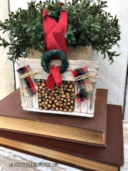 A DIY craft, Farmhouse Fireplace Ornament with a faux wood logs. This is a fun craft for kids to adults. Perfect for the country christmas decor style. A great present for a fixer upper fan. Great gift idea. Cost nothing but suplies on hand for most. Fun party activity.