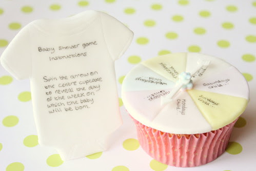 Baby Shower cake game instructions and spinning arrow cupcake.