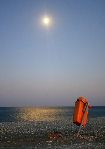 moon rising over the water at Lady's Mile, Cyprus