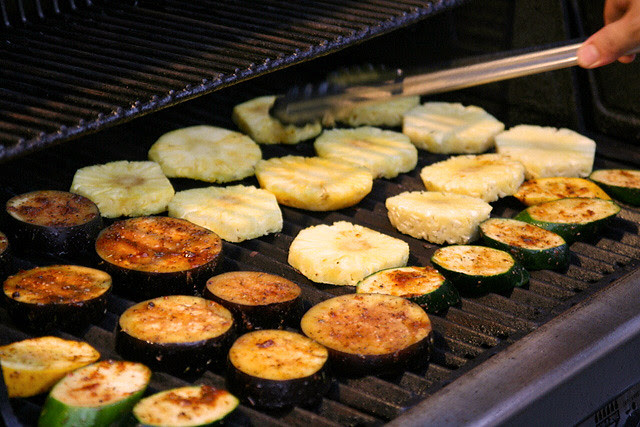Zucchini, eggplant and pineapples being grilled
