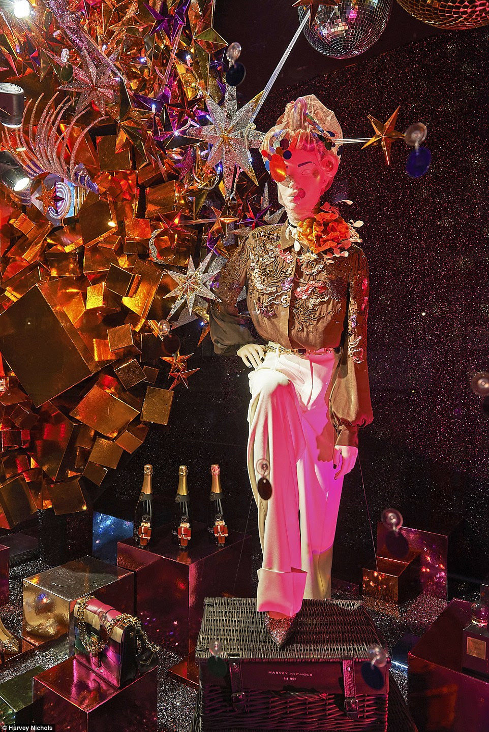 Wide-legged trousers with high-waists teamed with embellished shirts also celebrate the disco era in this festive window
