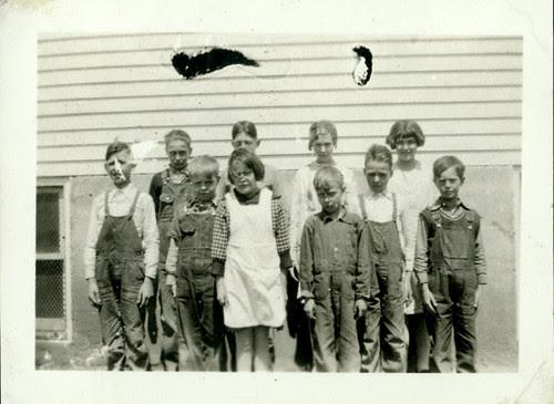 Ten kids in front of school house