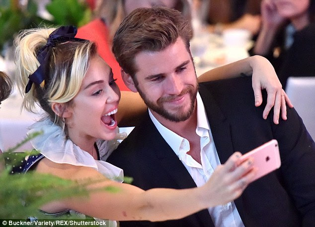 Loved up: Rumours began swirling that Miley and Liam were back together when they enjoyed a holiday in his native Australia together over New Year's Eve