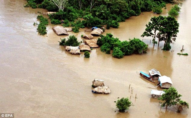 Strong El Niño events occur every 20 years or so, but researchers recently said this could drop to 10 years thanks to global warming. Here, the village of Puerto Maldonado, Peru, is seen flooded in January 2003 as a result of El Niño rains, which drove 16,000 people from their homes