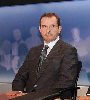 Journalist Pavlos Tsimas at the six party lead...