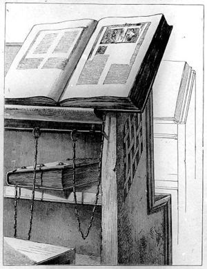 Desk with chained books in the Library of Cese...