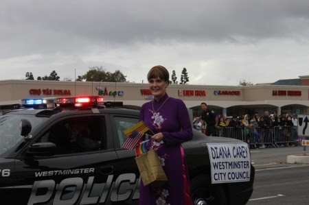 Westminster Councilwoman Diana Carey participates in the 2013 Tet Parade in Westminster holding LBGT Pride Flag in support of the LGBT group barred from participating in the parade.