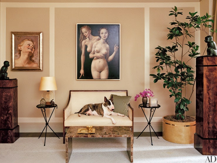 Marc Jacobs's master bedroom boasts six paintings by John Currin, a pair of Lalanne bronze monkeys, two Dominique armchairs covered in a Holly Hunt fabric, and an Alberto Giacometti floor lamp. The Jansen dresser and mirror are from Bernd Goeckler Antiques. Neville surveys the scene from a vintage settee; the low table is by Jean-Michel Frank. Floral design, here and throughout, by Ariel Dearie Flowers.