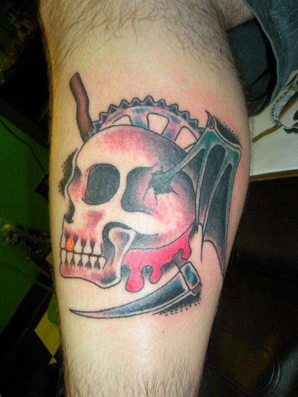 Skull And Chain Ring Tattoo