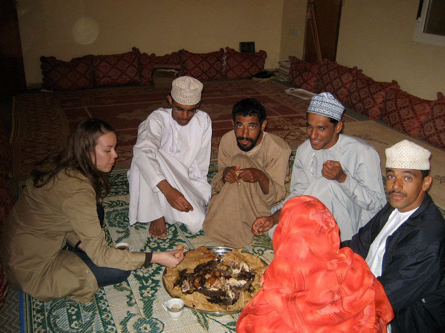 2012.01.03, Eating a traditional Omani meal of roasted lamb with a flat pancake like bread (Ibri, Oman)