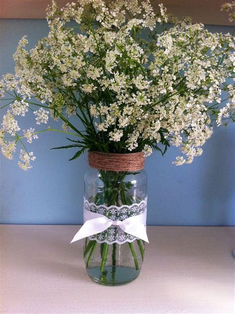 Handmade DIY rustic style vase made from an old jam jar