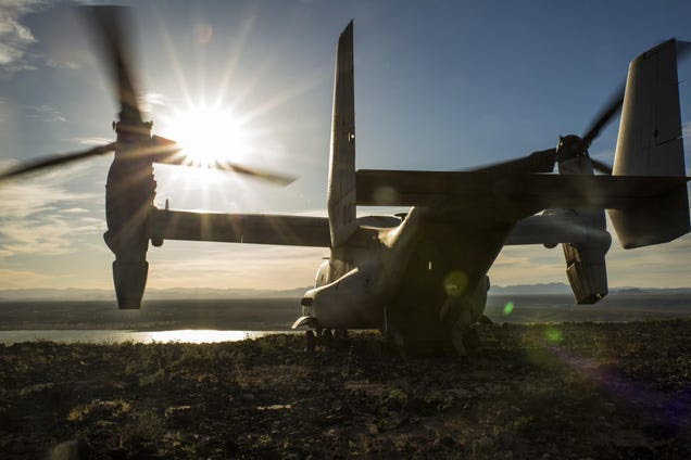 Peaceful shot of a MV-22 Osprey overlooking the Sun on top a mountain