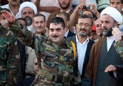 Samir Kuntar on arrival in Lebanon, complete with Hizbullah uniform and Heil Hitler nazi scumbag salute (AFP).