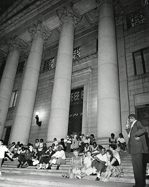 Description of  JUN 25 1963 - Overflow demonstrators wait on the steps after City Council Chambers filled up. They listened by loudspeakers to spokesmen at the race-relations meeting. (Duane Howell/The Denver Post)
