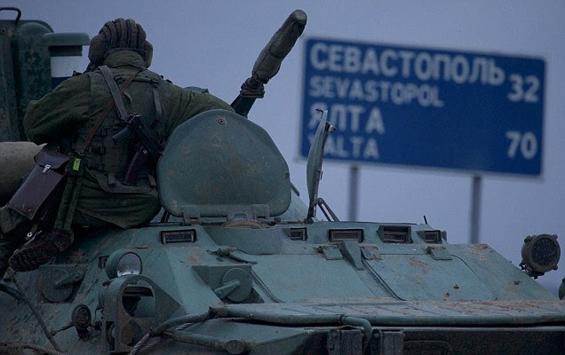 A Russian soldier on an armoured personnel carrier halted on a road in Ukraine around 20 miles from Sebastapol, where there is a large Russian military presence. British civilians have been told by the Foreign Office to leave Crimea immediately, although an evacuation has not been arranged.