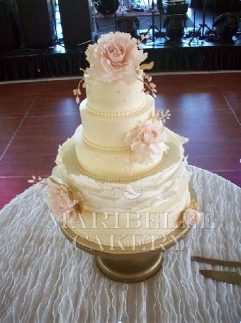 Blush And Gold Accents On A Buttercream Wedding Cake