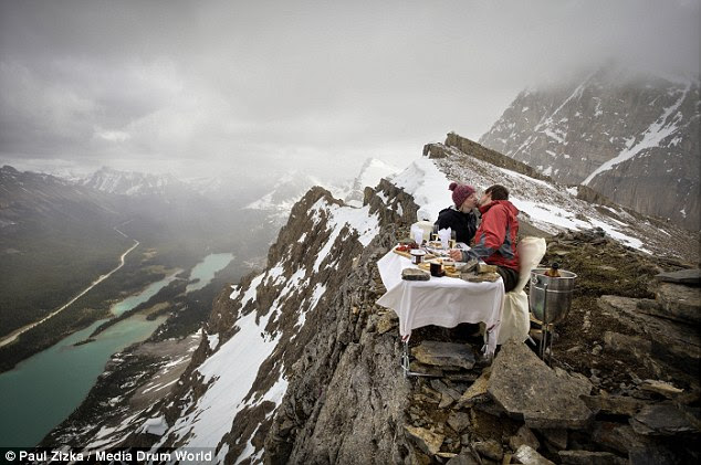 In June 2012 the pair were innkeepers at a lodge  and staff helped carry a table, food and chairs to the peak