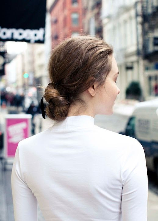 Le Fashion Blog Hair Tutorial Black Ribbon Tied Into Low Braided Bun White Mock Neck Turtleneck Top Via The Coveteur