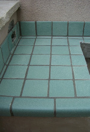 Finishing a tiled counter edge with a V-Cap trim tile