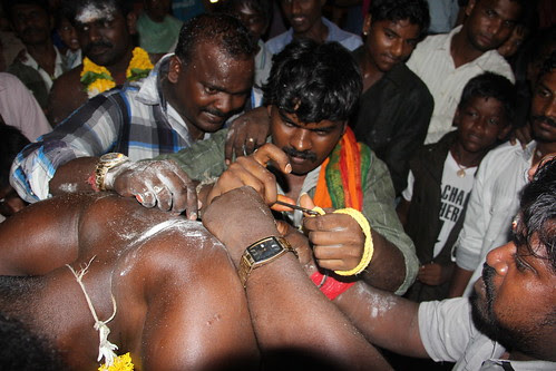 Fixing Hooks On Shanmughams Back  Is The Toughest Task For Madras Wadi People by firoze shakir photographerno1
