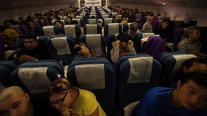 Passenger on the 12:35am Malaysia Airlines flight from Kuala Lumpur to Beijing. The flight has been renumbered  MH318 since the disappearance of MH370.