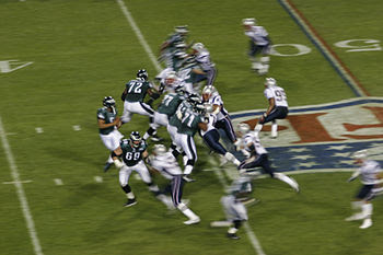 The Patriots defense rushes the Eagles offense...