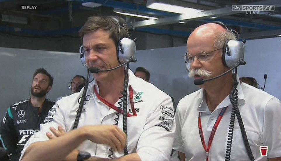 Mercedes chief Toto Wolff (left) reacts alongside Dieter Zetsche following Hamilton's disastrous start to the Italian Grand Prix