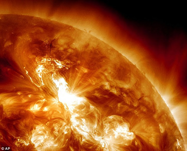 Bright lights: This image shows a solar flare erupting on the Sun's northeastern hemisphere. Space weather officials say the strongest solar storm in more than six years is already bombarding Earth