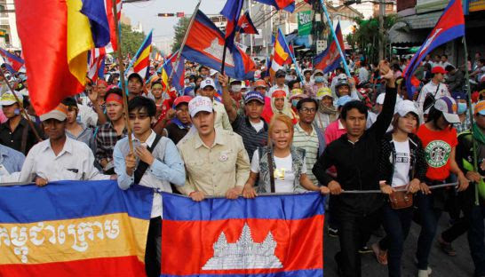 Cambodia National Rescue Party supporters lead demonstrators along Monivong Boulevard