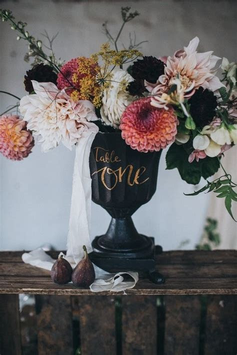 7 Wedding Centerpieces that Double as Table Numbers   Brides