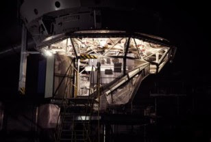 Caltech's Cosmic Web Imager installed in the Cassegrain cage of the Hale 200 inch telescope at Palomar Observatory. (Matt Matuszewski)